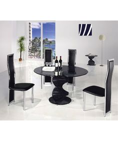 Amelia smoke #diningtable and smoked #diningchairs is an ideal option to be used at a #dinner party or for any other gathering.