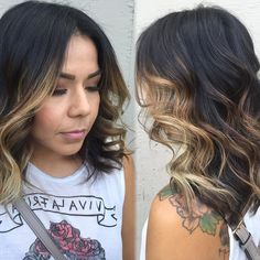 Wavy Black Hair with High-Contrast Copper Balayage