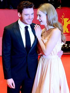 Star Tracks: Monday, February 16, 2015 | LAUGH OUT LOUD | Also at the Cinderella premiere in Berlin, Lily James and Richard Madden share a chuckle on the red carpet.