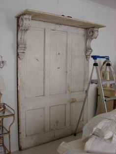 30 Modern Wall Decor Ideas Recycling Old Wood Doors for Unique Room Design - headboard made from old doors, corbels Best Picture For diy crafts For Your Taste You are looking - Headboard From Old Door, Headboard With Shelves, Headboard Door, Storage Headboard, Antique Door Headboards, Shabby Chic Headboard, Rustic Headboard Diy, Distressed Headboard, Custom Headboard