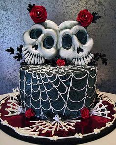 Spooky black halloween wedding cake with two skulls as the bride and groom cake topper. Description from pinterest.com. I searched for this on bing.com/images