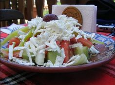 Bulgarian shopska salata is a refreshing salad of tomatoes, peppers, onion and parsley in a vinaigrette dressing.