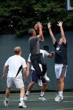 Barack Obama shooting hoops. THE BALL HAS A GODDAMN OBAMA LOGO ON IT.