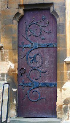 Old wooden door with beautiful hardware