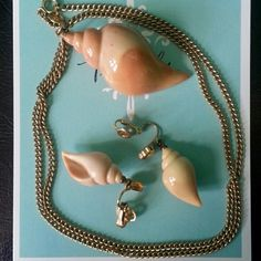 "Vtg Avon ""Shell"" Necklace and Earrings Set In excellent vintage condition. Goldtone. Chain is about 13"" (2nd pic) Please check all pictures. Thank you for browsing my closet ?? Vintage Avon Jewelry Necklaces"