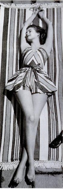 Matching stripe towel and swimsuit from 1956