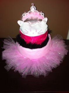 Princess diaper cake Includes 25 size 1 diapers, 1 hat, 1 tiara, and 1 tutu!   Order one today! Text 705-716-8741 or email me at t.denardis@hotmail.ca *Choose from pink, blue, or yellow/green. *Choose your diaper size (pull-ups can be used but raises the cost).  *can be shipped within Ontario or FREE pick up in the southern part of Barrie.  PLEASE NOTE: patterns and brands are subject to change.  Www.facebook.com/tinasdiapergifts