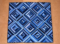 """Love this quilt using old denim jeans! Climbing the Walls by Lynne Miller-Deist.  (Looks like the strips are all different widths - except maybe the one down the center of each block - which then goes on to define the larger """"squares"""")"""
