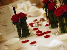 Pearls centerpieces with red Roses and black vases.  I like this idea but with light pink flowers or ivory....and glass vases