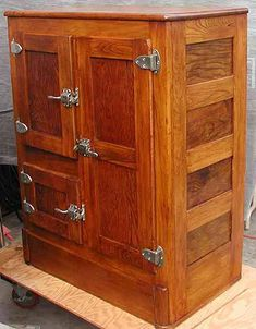 I have an old ice box almost exactly like this.  I'd love to restore it one day.