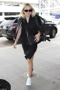 Heading out of town: Dakota Fanning chose to pair a black frock and jacket with…