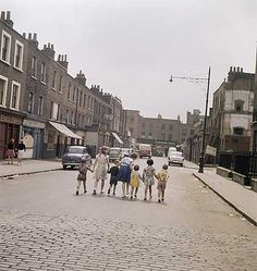 White Conduit Street towards the junction with Chapel Market in Islington. Much of the street was demolished to make way for Tolpuddle Street and a car park. PhotographerJohn Gay Date John Gay English Heritage NMR Vintage London, Old London, North London, London History, British History, Local History, London Boroughs, Make Way, English Heritage