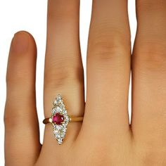 This Edwardian-era ring showcases an oval natural ruby in a light red hue…