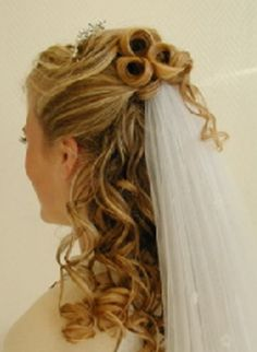 Half-up with veil under top half but do not like the crown and a little too curly... fo ally