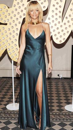 GIORGIO ARMANI, 2012 For an event during London Fashion Week, the star dazzled in this spaghetti-strap gown with a plunging v-neck, open back, and thigh-high slit that she teamed with gold Tom Ford python heels.