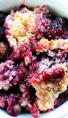 Berry Cobbler with a delicious blend of fresh blackberries, raspberries, blueberries, boysenberries, and strawberries. Topped with a coconut walnut streusel!