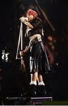 "Axl Rose. Guns 'n' Roses singer looks like a ""sweet child 'o mine"" in a black leather kilt. ..."