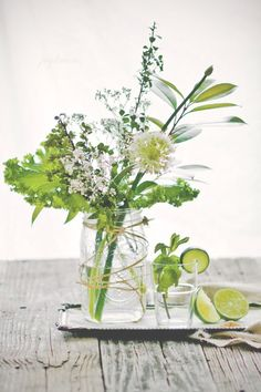 I love this! White and green flowers with lime slices on the water glasses! I'll cut the limes myself to make sure this happens!