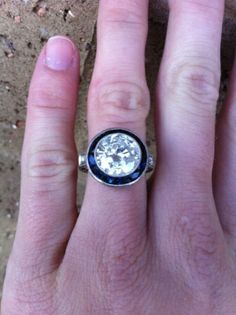 I like the setting of halo with no prongs for the sapphires...for Cori