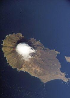 """松輪島 (Matsuwa-tō) is an uninhabited volcanic island near the center of the Chishima Islands chain in the Sea of Okhotsk to the northeast of Japanin, 16 kilometers (9.9 mi) across Golovnin Strait from Raikoke. Its name is derived from the Ainu language, from """"hellmouth""""."""