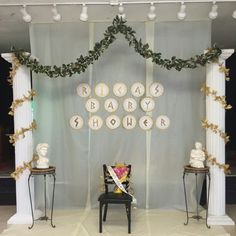 Backdrop for the stage of the greek-themed baby shower that I hosted. Purchased a roll of table cover for the back drop. Rented the 8 feet colonnade columns and the busts. Lettering made from gold poster board pasted onto a edge-cut doilies and again pasted onto a special paper. The vines were from Michael's.