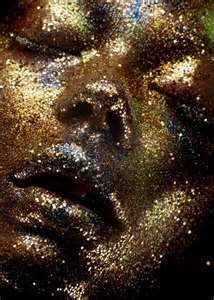 glitter covered face