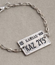 The Supernatural License Plate Bracelet is a replica of the exact one on Dean's beloved Impala. Perfect for Supernatural fans of all ages because this bracelet is fully adjustable. Destiel, Supernatural Fans, Supernatural Fashion, Supernatural Merchandise, Supernatural Convention, Winchester Brothers, Sam Winchester, Things To Buy, Stuff To Buy