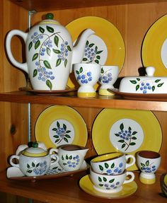 Isn't this a lovely collection of Blueberry Stangl?  I have many serving pieces, even the big teapot and warmer stand.  However, I have never even seen a butter cover.  This has got to be some of the happiest looking pottery around.  I like to use mind in the summer when we eat out on the back porch.  It just says summer fun to me.  This is American pottery - the Stangl factory was in New Jersey.