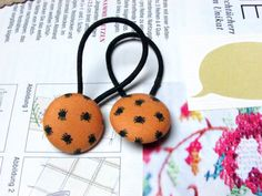 Check out this item in my Etsy shop https://www.etsy.com/listing/245561231/button-ponytail-holders-halloween