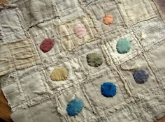 love the rustic simplicity... tired, stained cloth with dances of colour...
