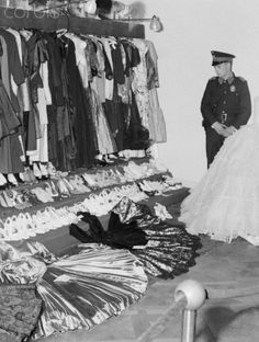 From Eva's closets. Above are some of the 400 dresses, 600 hats and dozens of pairs of shoes and boots. Her lavish wardrobe--enough to stock a department store was placed on public display in Buenos by Eduardo Lonardi. Also on exhibition for the enlightenment of Peron's once-adoring public were jewels, paintings, Ivory carvings and other riches with a total value of more than $6,500, 000. Fecha de la fotografía: 18 de octubre de 1955