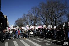 "Protesters holds up signs at the ""Not My President's Day"" rally protesting the presidency of President Donald Trump outside of Trump…"