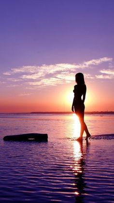 Girl-in-Sunset-Sea-iPhone-Wallpaper