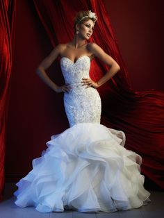 Statuesque and lovely, this strapless column gown is adorned with a sweep of ruffles at the hem.