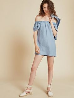 Nice collarbones. This is a mini length, off-the-shoulder dress with an elastic…