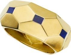 Lapis Lazuli, Gold Bracelet, Tiffany & Co. The hinged bangle features rectangular-shaped lapis lazuli tablets measuring 10.00 x 7.50 mm, set in brightly polished 18k gold, marked Tiffany, Italy. Bracelet is accompanied by its original signed Tiffany box.