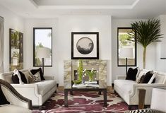 Elegant transitional style formal living room décor with holly hunt inspired sofas, classy living room décor, Gorgeous Traditional style all white living room decor with white tufted chesterfield sofa and crystal chandelier, white living room decor with white furniture, all white decor, glam beige living room
