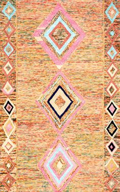 Get the bohemian look along with a lively mix of colors in this amazing hand-tufted Moroccan diamond patterned rug. It is a good combination of wool and viscose thereby making it soft, durable besides being versatile enough to liven up any living space of your home.