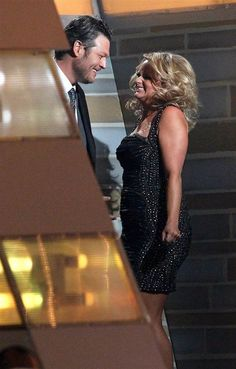"""Miranda Lambert hugs husband Blake Shelton backstage after winning for song of the year for """"Over You."""" The couple wrote the song together. (Photo: Ethan Miller / Getty Images) #ACMs"""