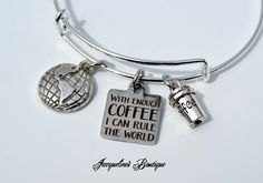 "Here's a Great ""Coffee-holic"", Expandable Bangle Bracelet. This Bracelet comes with one silver Earth charm, one silver coffee cup charm and one laser etched tag with the saying, ""With Enough Coffee I Can Rule The World"".  • Color: Silver • Expandable ..."