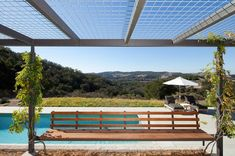 Industrial mesh used to create a pergola roof for growing vines on - perfect. Farmhouse Patio by Gast Architects