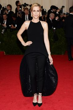 Kristen Wiig wore a Balenciaga by Alexander Wang dress and trousers.