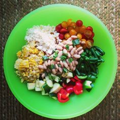A light and healthy summer veggie chopped salad with white beans, fresh herbs and dressed in a lemon vinaigrette.