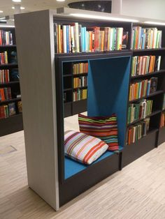"""I like the idea of creating reading nooks or """"caves"""" within shelving. This particular design may be more appropriate for High School students given the height of the shelves. Picture from Vallentuna Public Library (SE) BCI Design School Library Design, Home Library Design, Kids Library, Home Interior Design, Library Furniture Design, Teen Library Space, Library Ideas, Chair Design, Interior Ideas"""