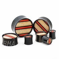 BMA Modified Skateboard Inlay on Black Anodized Steel Plugs
