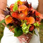 Absolutely stunning bridal bouquet done in fall colors of oranges, browns and greens.