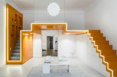 Lit staircases to loft bedroom in an apartment in Budapest, Hungary designed by batlab