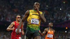 Gold medallist Usain Bolt of Jamaica celebrates