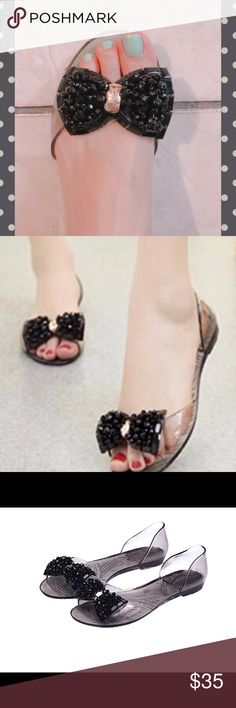 Jelly peep-toe sandals in black Oh so adorable!! The perfect jelly sandals with front bow design. Comfy, trendy , and super cute! Size 7.5...box displays size 38 which is 7/8 in US sizing. Only available in this color for this size. Material: rubber Shoes Sandals