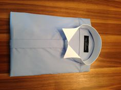 blue shirt with white wing collar
